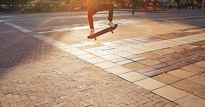 Buy stock photo Cropped shot of a skater doing a trick on his skateboard