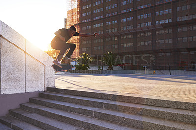 Buy stock photo Shot of a young skater skating down a flight of stairs