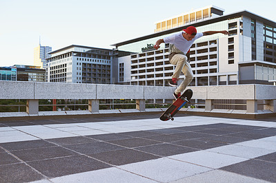 Buy stock photo Shot of a young man skating in the city