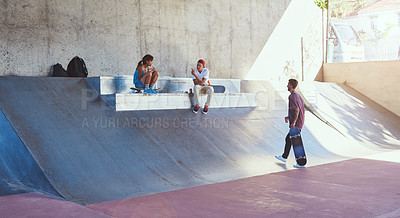 Buy stock photo Shot of skaters having lunch together