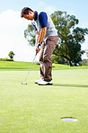 Golfer about to putt the ball