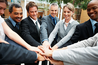 Buy stock photo Colleagues with their hands piled on top of one another