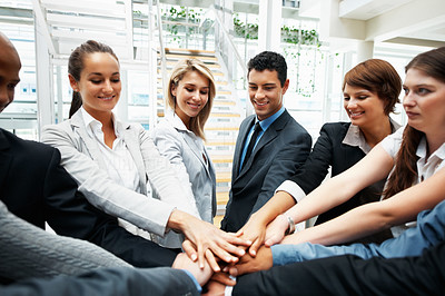 Buy stock photo Successful team with their hands piled on top of one another