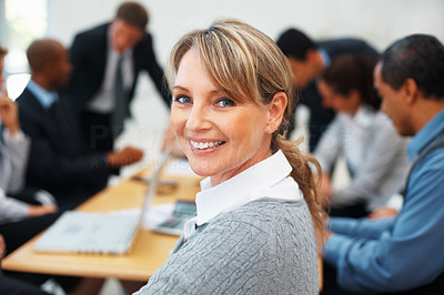 Buy stock photo Successful female executive smiling during meeting