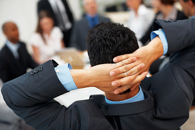 Buy stock photo Rear view of executive relaxing in chair during meeting