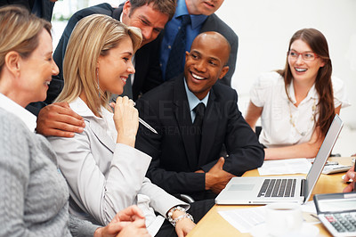Buy stock photo Executives looking at business woman and smiling during meeting