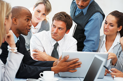 Buy stock photo Executive sharing his ideas while colleagues listen
