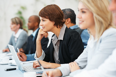Buy stock photo Focus on attractive business woman smiling during meeting