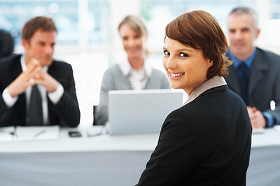 Buy stock photo Portrait of woman giving an attractive smile with panel of interviewers in background