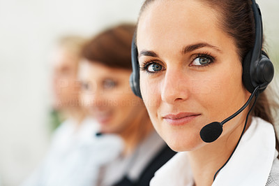 Buy stock photo Closeup of call center executive with team in background