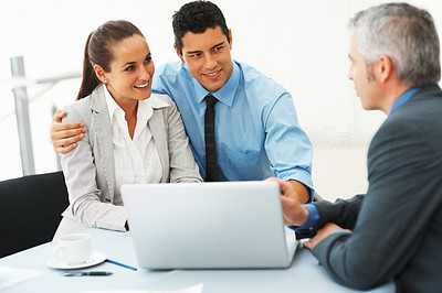 Buy stock photo Business couple in conversation with male consultant