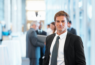 Buy stock photo Portrait of handsome business man with colleagues in background