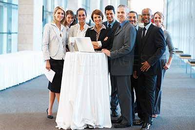 Buy stock photo Full length of smiling business executives standing with laptop