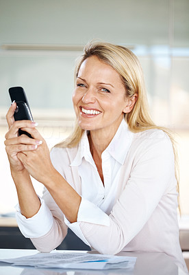 Buy stock photo Portrait of a beautiful young woman using mobile phone while sitting at her desk