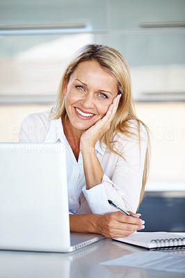 Buy stock photo Portrait of a smiling businesswoman taking note in a notepad  at office