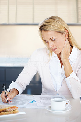 Buy stock photo Portrait of a smart young woman writing while having tea in office