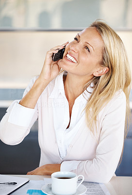 Buy stock photo Portrait of a happy young businesswoman talking on mobile phone with a cup of coffee on her desk