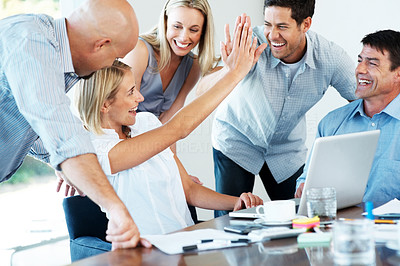 Buy stock photo Portrait of an excited businesspeople giving each other high five for successful business at office