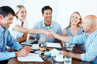 Buy stock photo Portrait of successful businesspeople shaking hands positively in a meeting