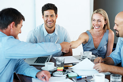 Buy stock photo Portrait of successful business colleagues shaking hands with eachother - Staff meeting