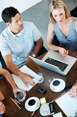 Buy stock photo Top view of  businesspeople working together on a business project at office