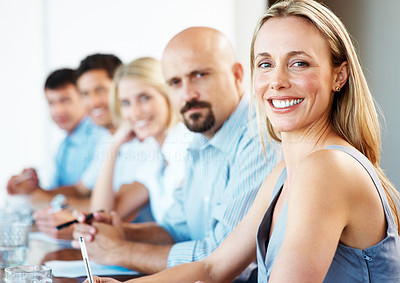 Buy stock photo Portrait of a happy young businesswoman in a meeting with her business colleagues