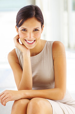 Buy stock photo Portrait of beautiful young businesswoman sitting with hand on chin and smiling