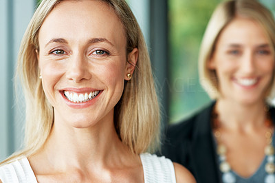 Buy stock photo Portrait of a pretty young businesswoman smiling with her friend in the background
