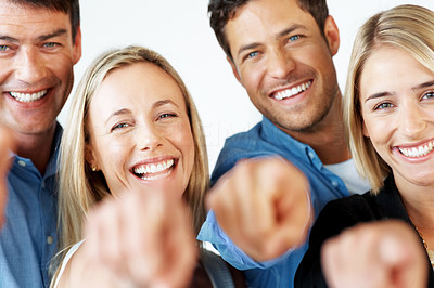 Buy stock photo Portrait of a smiling business people pointing at you against white background