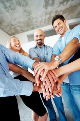 Buy stock photo Portrait of successful business people putting their hands on top of each other