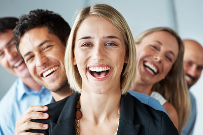 Buy stock photo Portrait of a happy young female business leader stading in front of her team