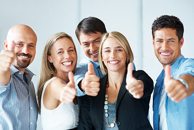 Buy stock photo Business approval - Portrait of confident young colleagues with thumbs up sign