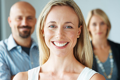 Buy stock photo Closeup portrait of a cute successful business woman with colleagues in the back