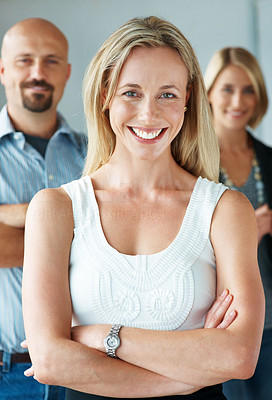 Buy stock photo Portrait of a happy business woman with her staff in the background