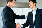 Joined in business - Businesspeople shaking hands