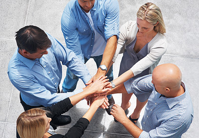 Buy stock photo Top view of united business people with hands together