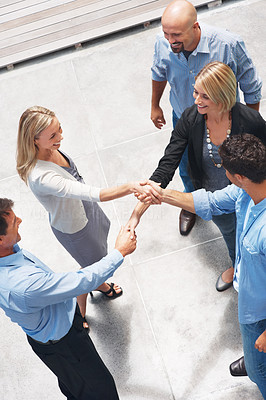 Buy stock photo Top view image of successful business people shaking hands with eachother