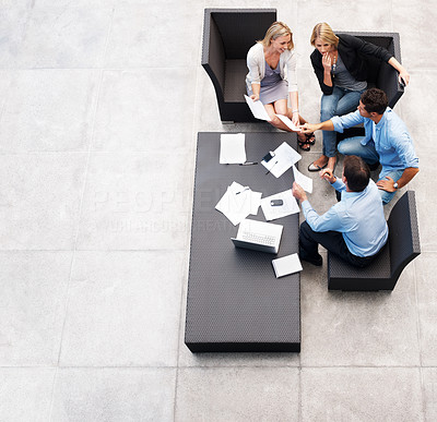 Buy stock photo Top view of successful businesspeople sitting together working on business planning