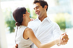 Romantic young couple dancing and laughing together