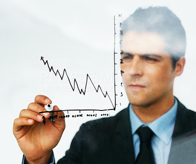 Buy stock photo Businessman drawing a chart representing growth in his company