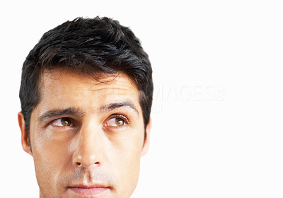 Buy stock photo Closeup of handsome man looking up with serious look