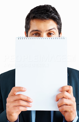 Buy stock photo Young businessman holding up notepad