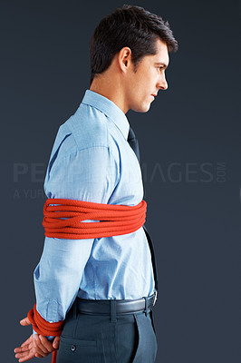 Buy stock photo Side view of executive tied up with rope