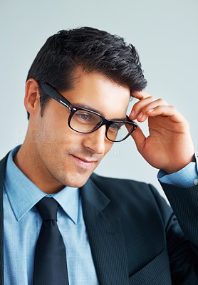 Buy stock photo Young business man in glasses looking into distance