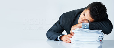 Buy stock photo View of businessman resting on stack of paperwork