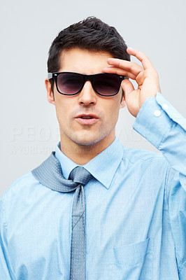 Buy stock photo Closeup of smart business man adjusting sunglasses