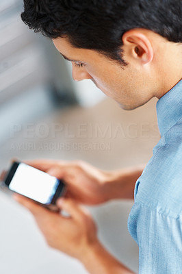 Buy stock photo Top view of man looking at cell phone