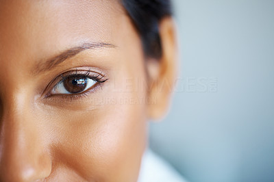Buy stock photo Cropped macro image of a beautiful woman's eye alongside copyspace