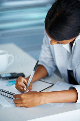 Buy stock photo View of business woman making notes