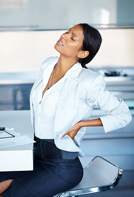 Buy stock photo Female executive stretching back inside office